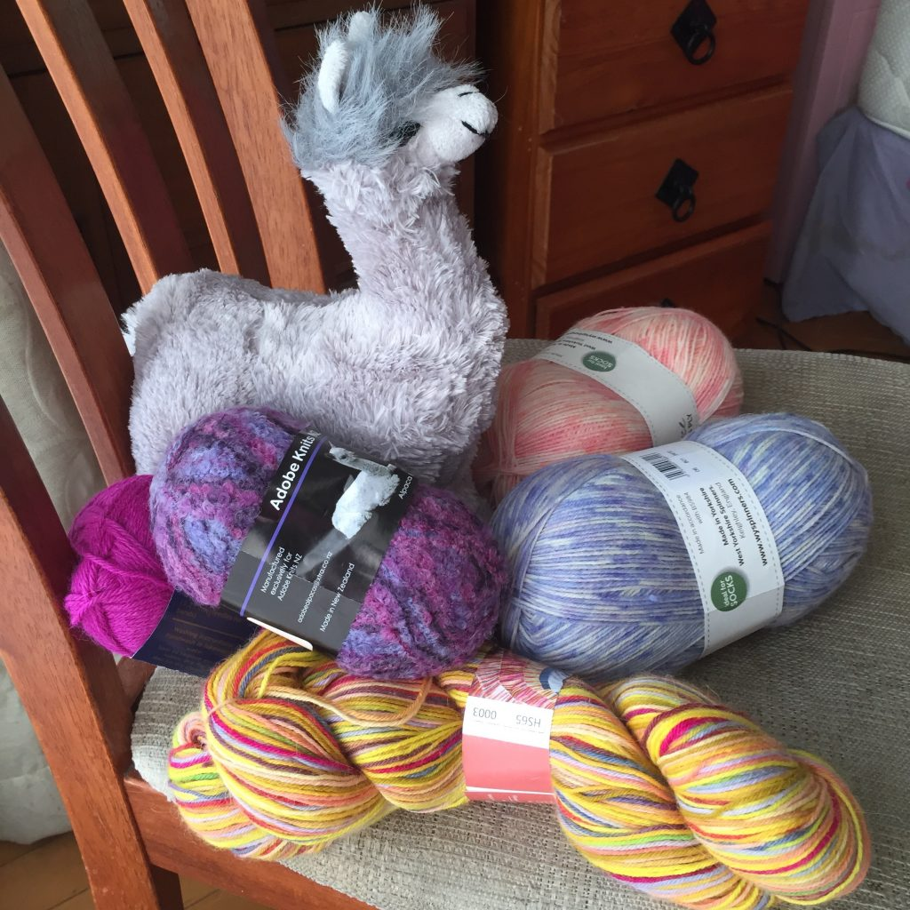Balls of wool and an alpaca