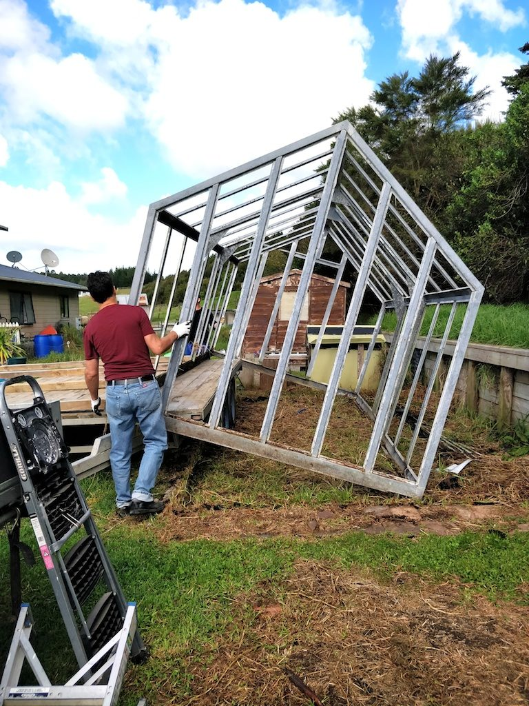 Moving a greenhouse frame